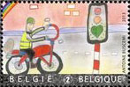 Children painting with bicyle in traffic
